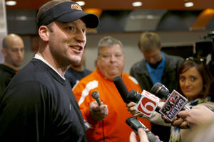 Photo - OKLAHOMA STATE UNIVERSITY / OSU / COLLEGE FOOTBALL: Oklahoma State offensive coordinator Mike Yurcich talks with the media prior to an OSU spring football practice in Stillwater, Okla., Wednesday, March 13, 2013. Photo by Bryan Terry, The Oklahoman