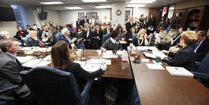 Photo - A standing-room-only crowd fills the room Thursday during a state Board of Education meeting in Oklahoma City. The state Education  Department is releasing A-F grades for schools throughout the state.  Photo By Paul Hellstern. The Oklahoman