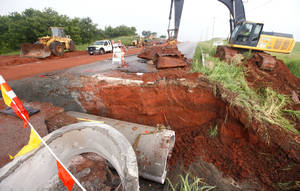 Photo - Construction crews are working to repair a section of NW 150 between May Ave. and Portland in Oklahoma City, OK, Monday, which was washed out by heavy rains. Photo by Paul Hellstern, The Oklahoman <strong>PAUL HELLSTERN</strong>