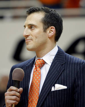Photo - Doug Gottlieb speaks during a halftime ceremony honoring the 10 men killed in the 2001 plane crash at the basketball game between Oklahoma State and Texas, Wednesday, Jan. 26, 2011, at Gallagher-Iba Arena in Stillwater, Okla. Photo by Sarah Phipps, The Oklahoman ORG XMIT: KOD