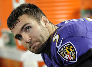 Photo - Baltimore Ravens quarterback Joe Flacco sits on the sideline in the second half of an NFL football game against the New England Patriots, Sunday, Dec. 22, 2013, in Baltimore. (AP Photo/Nick Wass)