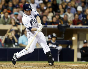 Photo - San Diego Padres' Jedd Gyorko connects for a grand slam home run off Miami Marlins starting pitcher Jose Fernandez during the sixth inning of a baseball game Friday, May 9, 2014, in San Diego. It was  Gyorko's second homer of the game and gave him six runs-batted-in. (AP Photo/Lenny Ignelzi)