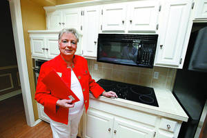 Photo - Susanne Crenshaw, a sales associate with Keller Williams Central Oklahoma in Edmond, shows the kitchen of a home she recently sold at 4417 Dahoon Drive in Oklahoma City. She is a finalist for Realtor Magazine's Good Neighbor Award. <strong>PAUL B. SOUTHERLAND - The Oklahoman</strong>