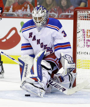 Photo - New York Rangers goalie Henrik Lundqvist, from Sweden, uses his skate to block a shot in the first period of an NHL hockey game against the Washington Capitals, Wednesday, Oct. 16, 2013, in  Washington. The Rangers won 2-0. (AP Photo/Alex Brandon)