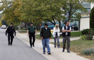 Photo -   Police walk the streets looking for clues in the search for ten-year-old Jessica Ridgeway near her home in Westminster, Colo., on Wednesday, Oct. 10, 2012. The youngster has been missing since she left her home Friday morning on her way to school. (AP Photo/Ed Andrieski)