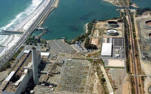 Photo - This image provided by the San Diego County Water Authority shows an artist rendering of a proposed desalination plant, center right, superimposed over an aerial photograph, in Carlsbad, Calif.  The proposed plant will be the Western Hemisphere's largest desalination plant. (AP Photo/San Diego County Water Authority)