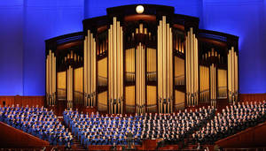 Photo - Members of the Mormon Tabernacle Choir perform during the opening session of the two-day Mormon church conference Saturday, Oct. 5, 2013, in Salt Lake City. The president of the Mormon church says worldwide membership has hit 15 million, representing a three-fold increase over the three decades. President Thomas S. Monson announced the milestone during the opening session of the two-day Mormon church conference Saturday morning. The biannual general conference of The Church of Jesus Christ and Latter-day Saints brings 100,000 members to Salt Lake City. More than half of church members live outside of the United States. (AP Photo/Rick Bowmer)