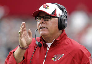 Photo - Arizona Cardinals head coach Bruce Arians signals a play against the Dallas Cowboys during the second half of a preseason NFL football game on Saturday, Aug. 17, 2013, in Glendale, Ariz. The Cardinals won 12-7. (AP Photo/Rick Scuteri)