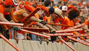 photo - Oklahoma State students beat their  paddles against a wall prior to a college football game between Oklahoma State University (OSU) and the University of Texas (UT) at Boone Pickens Stadium in Stillwater, Okla., Saturday, Sept. 29, 2012. Photo by Bryan Terry, The Oklahoman