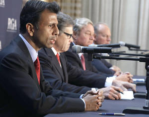Photo - Members of the Republican Governors Association, from left, Louisiana Gov. Bobby Jindal, Gov. Texas Gov. Rick Perry, North Dakota Gov. Jack Dalrymple and Wyoming Gov. Matt Mead, speak during a press conference about Environmental Protection Agency regulations on Monday, June 16, 2014, in Houston. The EPA recently released new rules designed to cut greenhouse gas emissions from existing coal-fired power plants. (AP Photo/Pat Sullivan)
