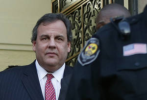 "Photo - New Jersey Gov. Chris Christie leaves City Hall Thursday, Jan. 9, 2014, in Fort Lee, N.J. Christie traveled to Fort Lee to apologize in person to Mayor Mark Sokolich. Moving quickly to contain a widening political scandal, Christie fired one of his top aides Thursday and apologized repeatedly for the ""abject stupidity"" of his staff, insisting he had no idea anyone around him had engineered traffic jams to get even with a Democratic mayor. (AP Photo/Kathy Willens)"