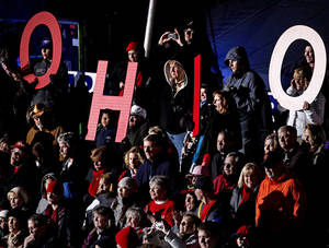 photo -   Supporters spell out &quot;Ohio&quot; as they cheer for Republican presidential candidate, former Massachusetts Gov. Mitt Romney, not pictured, as he speaks during a campaign event at The Square at Union Centre, Friday, Nov. 2, 2012, in West Chester, Ohio. (AP Photo/David Goldman)  