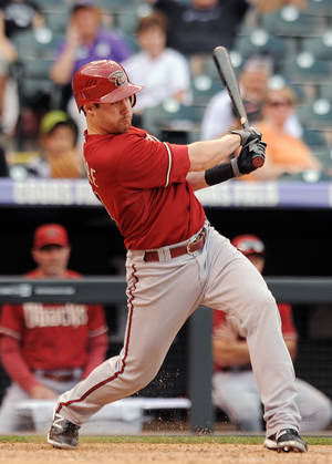 Photo -   Arizona Diamondbacks Jake Elmore hits a two-run single in the ninth inning of a baseball game against the Colorado Rockies in Denver on Sunday, Sept. 23, 2012. The Diamondbacks won 10-7. (AP Photo/Chris Schneider)