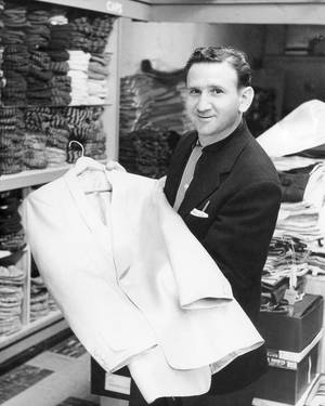 Photo -   In this 1957 photo provided courtesy of the Bernard J. Lansky Collection, clothier Bernard Lansky displays a jacket in his high-fashion store in Memphis, Tenn. Lansky, known as the clothier to rock and roll icon Elvis Presley, died Thursday, Nov. 15, 2012 at age 85 in Memphis. (AP Photo/Courtesy of the Bernard J. Lansky Collection) MANDATORY CREDIT