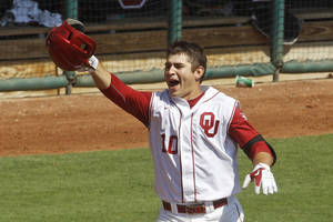 photo - Oklahoma's Garrett Carey celebrates as he rounds the bases after hitting the game-winning home run in the ninth inning against Oklahoma State at the Big 12 Conference baseball tournament in Oklahoma City, Wednesday, May 23, 2012. Oklahoma won 1-0. (AP Photo/Sue Ogrocki) ORG XMIT: OKSO106