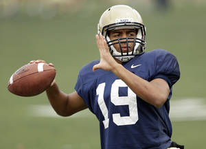Photo - Navy quarterback Keenan Reynolds throws during practice in Oakland, Calif., Wednesday, Dec. 26, 2012.  Navy plays Arizona State in the Fight Hunger Bowl NCAA college football game in San Francisco on Saturday.  (AP Photo/Marcio Jose Sanchez)