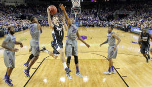 Photo - Gonzaga's David Stockton (11) goes to the basket against Kansas State's Wesley Iwundu during the first half of an NCAA college basketball game Saturday, Dec. 21, 2013. (AP Photo/The Wichita Eagle, Travis Heying)