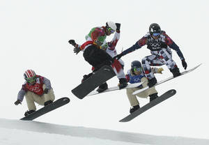 Photo - United States' Trevor Jacob, from left, Spain's Lucas Eguibar, Canada's Kevin Hill, United States' Alex Deibold, and Russia's Nikolay Olyunin compete during the men's snowboard cross semifinal at the Rosa Khutor Extreme Park, at the 2014 Winter Olympics, Tuesday, Feb. 18, 2014, in Krasnaya Polyana, Russia. (AP Photo/Jae C. Hong)