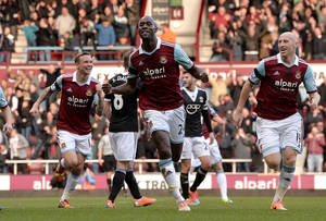 Photo - West Ham United's Carlton Cole, centre,  celebrates scoring his side's second goal of the game,  during the English Premier League match against Southampton, at Upton Park, London, Saturday Feb.  22, 2014. (AP Photo/PA, Anthony Devlin) UNITED KINGDOM OUT: NO SALES: NO ARCHIVE