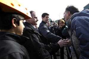 Photo -   Republican vice presidential candidate, Rep. Paul Ryan, R-Wis., greets a supporter at a tailgate party for the football game between the Green Bay Packers and the Arizona Cardinals at Lambeau Field, Sunday, Nov. 4, 2012 in Green Bay, Wis. (AP Photo/Mary Altaffer)