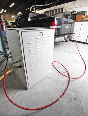photo - HYPRES Equipment has developed a home-fueling system for compressed natural gas vehicles. Photo By David McDaniel, The Oklahoman