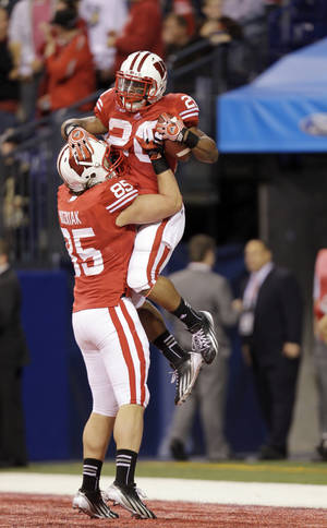 photo - Wisconsin running back James White (20) celebrates with Brian Wozniak after White ran 68 yards for a touchdown during the second half of the Big Ten Conference championship NCAA college football game against Nebraska Saturday, Dec. 1, 2012, in Indianapolis. (AP Photo/Michael Conroy)