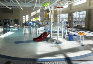 Photo - A traditional pool for swimming lessons and lap swimming with a 130-foot twisting slide  are part of the new Mitch Park YMCA scheduled to open Feb. 3. PHOTO BY PAUL HELLSTERN, THE OKLAHOMAN. <strong>PAUL HELLSTERN - THE OKLAHOMAN</strong>