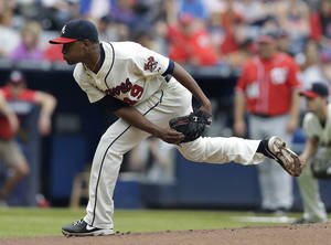 Photo - Atlanta Braves starting pitcher Julio Teheran works in the first inning of a baseball game against the Washington Nationals in Atlanta, Sunday, Aug. 18, 2013. (AP Photo/John Bazemore)