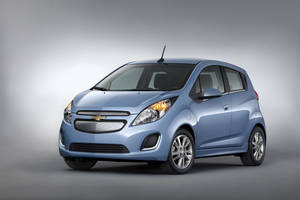 Photo - HOLD FOR RELEASE UNTIL 12:01AM TUESDAY, NOV. 26, 2012-This undated image provided by General Motors shows the 2014 Chevrolet Spark EV, which will be unveiled at the 2012 Los Angles Auto Show during the week of Nov. 26, 2012. The five-door urban mini car is priced at under $25,000 with tax incentives. (AP Photo/General Motors)