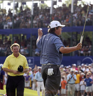 Photo -   Jason Dufner, right, reacts after defeating Ernie Els, left, during a sudden death playoff at the Zurich Classic golf tournament at TPC Louisiana in Avondale, La., Sunday, April 29, 2012. (AP Photo/Eliot Kamenitz, The Times-Picayune)