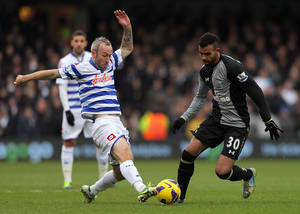 photo - Tottenham Hotspur's Raniere Sandro, right, and Queens Park Rangers' Shaun Derry battle for the ball during the English Premier League soccer match at Loftus Road, London, Saturday Jan. 12, 2013. The match ended in a 0-0 draw. (AP Photo/PA, Nick Potts) UNITED KINGDOM OUT