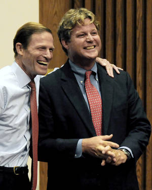 Photo - FILE - In this Oct. 16, 2010 file photo, Ted Kennedy Jr., right, shares a light moment with Connecticut Attorney General Richard Blumenthal, who was campaigning for U.S. Senator in Connecticut, in New Haven, Conn. Two people told The Associated Press on Monday, April 7, 2014, that Kennedy, son of the late U.S. Sen. Ted Kennedy of Massachusetts, will announce on Tuesday he intends to seek the Democratic nomination for the 12th Senatorial District seat, being vacated by retiring Guilford, Conn., Edward Meyer.  (AP Photo/Bob Child, File)