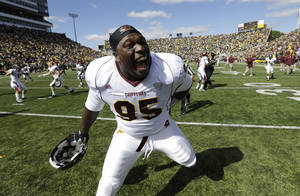 Photo -   Central Michigan defensive lineman Shafer Johnson celebrates after his team's 32-31victory over Iowa in an NCAA college football game, Saturday, Sept. 22, 2012, in Iowa City, Iowa. (AP Photo/Charlie Neibergall)