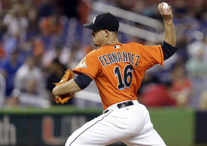 Photo - Miami Marlins starting pitcher Jose Fernandez (16) throws in the first inning during a baseball game against the Los Angeles Dodgers, Monday, Aug. 19, 2013, in Miami. (AP Photo/Lynne Sladky)