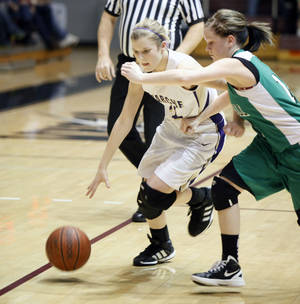 Photo - Okarche's Kanadey Grellner drives around Stonewall's Shelby Seeley during the girl's class A basketball playoffs at Southern Nazarene University's Sawyer Center in Bethany, OK, Thursday, March 1, 2012. By Paul Hellstern, The Oklahoman