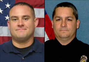 Photo - This combination of undated photos provided by the Topeka, Kan., Police Department shows Officer Jeff Atherly, left, 29, and Cpl. David Gogian, 50, who were fatally shot outside a Topeka grocery store Sunday, Dec. 16, 2012 while responding to a report of a suspicious vehicle, authorities said. Authorities say a man suspected in the fatal shooting of Atherly and Gogian has died after an armed standoff with law enforcement at a house in Topeka, Kan.  (AP Photo/Topeka Police Department)