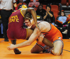 Photo - Oklahoma State 184-pound wrestler Nolan Boyd takes down Iowa State's Boaz Beard at a wrestling dual between Oklahoma State and Iowa State at Gallagher Iba Arena in Stillwater on January 24, 2014. Oklahoma State defeated Iowa State 29-3. Photo by KT King/For the Oklahoman