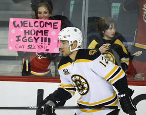 Photo - Boston Bruins' Jarome Iginla takes part in the pre-game skate before first period NHL hockey action against the Calgary Flames in Calgary, Alberta Tuesday, Dec. 10, 2013. (AP Photo/The Canadian Press, Jeff McIntosh)