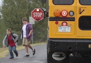 Photo - CHILD / CHILDREN / KIDS: A school bus with flashers on unloads students on Thursday, Oct. 27, 2011, in Newcastle, Okla.    Photo by Steve Sisney, The Oklahoman ORG XMIT: KOD