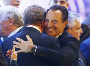 Photo - England manager Roy Hodgson hugs Italy head coach Cesare Prandelli, right, after the draw ceremony for the 2014 soccer World Cup in Costa do Sauipe near Salvador, Brazil, Friday, Dec. 6, 2013. (AP Photo/Victor R. Caivano)