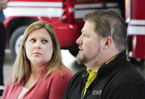 Photo - Erica and Jeff Buchanan discuss his heart attack three years ago when firefighters helped save his life.  Photo by David McDaniel, The Oklahoman <strong>David McDaniel</strong>