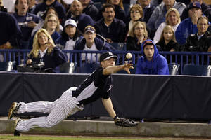 Photo - New York Yankees' Dan Johnson dives as he tosses the ball to first base on a ground out by Atlanta Braves' Freddie Freeman during the third inning of a spring training exhibition baseball game, Tuesday, March 5, 2013, in Tampa, Fla. (AP Photo/Matt Slocum)