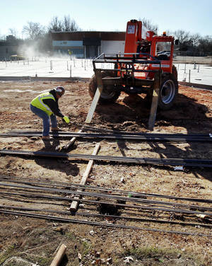 Photo - Construction workers lay the groundwork for a new Administrative Services Center building for the Norman school district at 131 S Flood Ave. PHOTO BY STEVE SISNEY, THE OKLAHOMAN