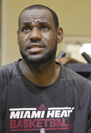 Photo -   Miami Heat forward LeBron James speaks during an interview after NBA basketball training camp, Tuesday, Oct. 2, 2012 in Miami. (AP Photo/Wilfredo Lee)