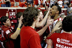 Photo - Oklahoma's Romero Osby (24) celebrates with fans after the Bedlam men's college basketball game between the University of Oklahoma Sooners and the Oklahoma State Cowboys in Norman, Okla., Wednesday, Feb. 22, 2012. Oklahoma won 77-64. Photo by Bryan Terry, The Oklahoman