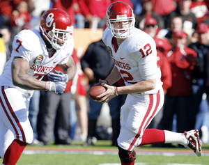 Photo - This spring, Oklahoma quarterback Landry Jones, right, has continued the good play he showed in the Sooners' Sun Bowl win. Photo by Steve Sisney, The Oklahoman