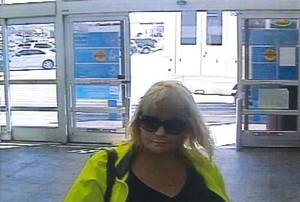 Photo -  Oklahoma City police are searching for two women, one of whom is seen in this image taken from surveillance video, who are suspected of using counterfeit checks and stolen credit cards. IMAGE PROVIDED  <strong></strong>