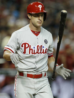 Photo - Philadelphia Phillies' Jayson Nix flips his bat in the air after striking out against the Arizona Diamondbacks during the ninth inning of a baseball game on Friday, April 25, 2014, in Phoenix.  The Diamondbacks defeated the Phillies 5-4. (AP Photo/Ross D. Franklin)