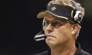 photo - In a Sunday Sept. 26, 2010 photo Saints defensive coordinator Gregg Williams stands on the sidellines during an NFL football game at the Louisiana Superdome in New Orleans, La. The Titans have talked with suspended defensive coordinator Williams and are interested in hiring him, said a person familiar with the situation Sunday Jan. 27, 2013.  (AP Photo/Gerald Herbert)