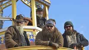 Photo - NEW YORK, NY - NOVEMBER 28:  A&E Duck Dynasty-Phil Robertson, Willie Robertson and Jase Robertson attend the 87th annual Macy's Thanksgiving Day parade on November 28, 2013 in New York City.  (Photo by Eugene Gologursky/WireImage)